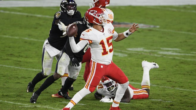 Kansas City Chiefs quarterback Patrick Mahomes (15) throws during the first half of an NFL football game against the Baltimore Ravens, Monday, Sept. 28, 2020, in Baltimore.
