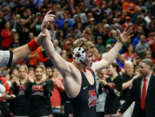 Fort Dodge's Brody Teske celebrates after beating Kaleb Olejniczak of Perry during their class 3A 126 pound championship match at Wells Fargo Arena on Saturday, Feb. 17, 2018, in Des Moines. This was Teske's his fourth state title.