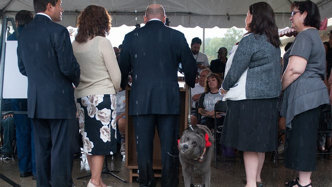 Camden County Freeholder Jeff Nash and his Dog Norman stand at the podium in October, announcing new legislation that prohibits the sale of puppy mills pets in  Camden County.