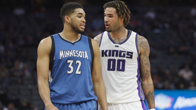 Former Kentucky teammates, Minnesota Timberwolves center Karl-Anthony Towns, left, and Sacramento Kings center Willie Cauley-Stein talk during a timeout in the second half of an NBA basketball game Monday, Feb. 27, in Sacramento, Calif.