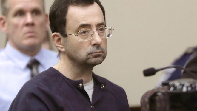 In this Jan. 24, 2018, file photo, Larry Nassar, a former doctor for USA Gymnastics and member of Michigan State's sports medicine staff, sits in court during his sentencing hearing in Lansing, Mich.