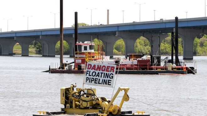 Brennan dredging units work on the Fox River near Wisconsin 172 as part of the PCB removal project in 2012. Four paper companies, the city of Appleton and the Neenah-Menasha Sewerage Commission agreed to a $54.1 million settlement Wednesday over the PCB discharge into the river.