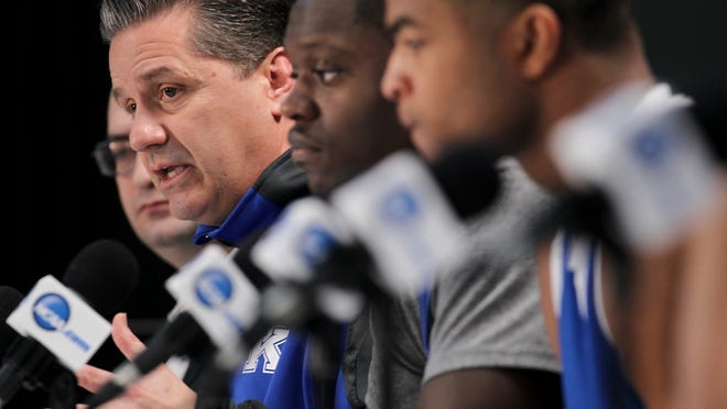 UK head coach John Calipari, left, speaks to the media during a press conference before the national championship game against UConn at the AT&T Stadium.
