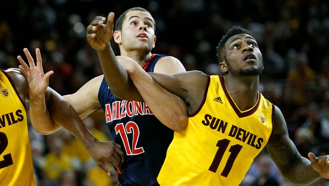 Arizona's Ryan Anderson (12) and Arizona State's Savon Goodman battle for position under the basket during the second half of an NCAA college basketball game, Sunday, Jan. 3, 2016, in Tempe.