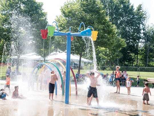 Kids cool off at the Goodells County Park splash pad
