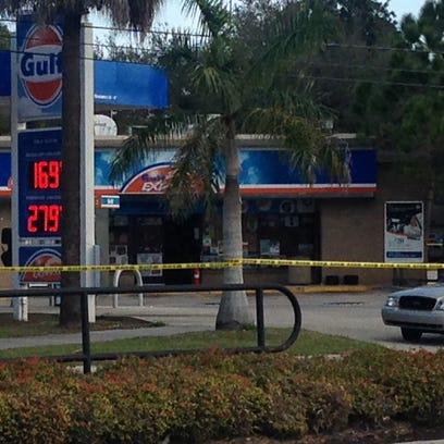 A Gulf convenience store is cordoned off by crime scene