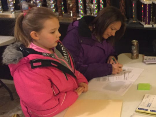 Kendra Bucciarelli signs up her daughter, Cara, for