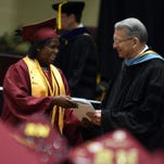Shay Williams receives her diploma from Pearl River Community College President William Lewis during May's graduation ceremony.