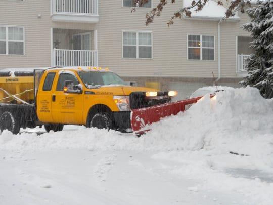 Plow clear the heavy snow at Wayne, NJ.