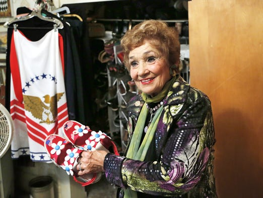 Sheila Klinker show off one of her favorite pairs of shoes Wednesday, June 11, 2014, in her Lafayette home. Klinker said she wears the shoes with a patriotic theme for July Fourth celebrations. The popular State Representative is well known for her unique fashions.