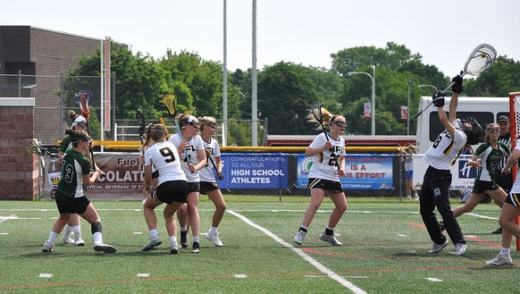 Honeoye Falls-Lima goalie Bridgette Ratliff snares shot from Brewster's Sam DeLeo during a Class C New York State semifinal game at SUNY Cortland on Friday, June 8th, 2018.