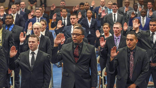 Fifty nine new recruits joined the Indianapolis Metropolitan Police Department during swearing-in ceremony for the 16th sworn recruit class at the Public Safety Training Academy Monday, December 18, 2017.