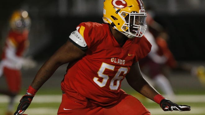 Clarke Central's Montavious Cunningham (56) looks to block during an GHSA high school playoff football game between Clarke Central and M.L. King in Athens, Ga., on Friday Nov. 27, 2020. Clarke Central won 41-20.