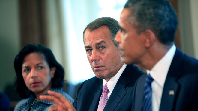 U.S. House Speaker John Boehner, R-OH, looks on as U.S. President Barack Obama meets with members of Congress in the cabinet room of the White House.