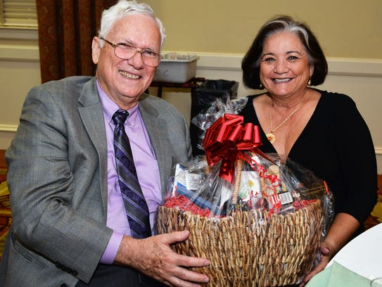Dr. Bob Cerveny shares his raffle winning with wife,