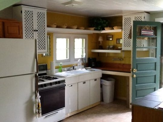 A one-bedroom old cottage in Grayling on the Au Sable is under $500 a week. Here's the cozy kitchen.
