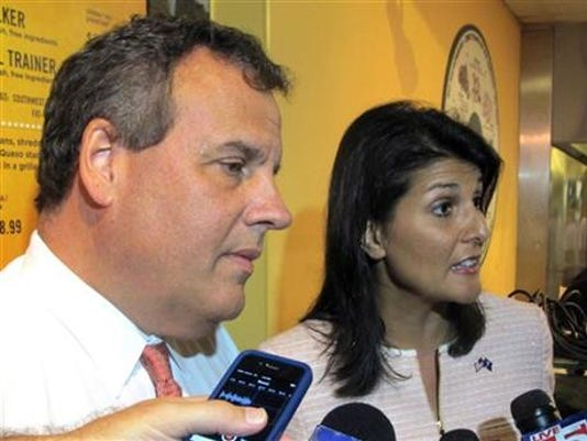 Gov. Chris Christie, left, and South Carolina Gov. Nikki Haley answer questions from reporters in Charleston, S.C., on Tuesday, Sept. 16, 2014. (AP Photo/Bruce Smith)