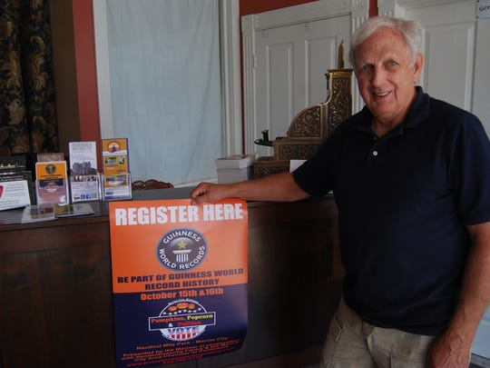 Gary Kohs of the Mariner Theater is trying to break two world records and get people to vote.