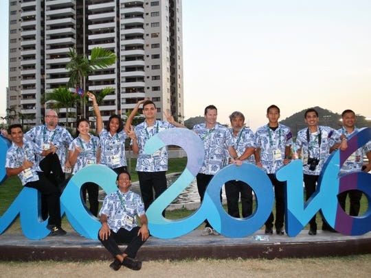 Team Guam at the 2016 Rio Olympics. From left: Chef de Mission Joey Miranda III, cyclist Peter Lombard, physio Chris Spalding, swimmer Pilar Shimizu, sprinter Regine Tugade, swimmer Ben Schulte, mountain bike coach Chris Clarke, swim coach Don San Agustin, runner Josh Ilustre, athletics coach Derek Mandel and team doctor Luis Cruz. At foreground is GNOC press attache Jojo Santo Tomas.