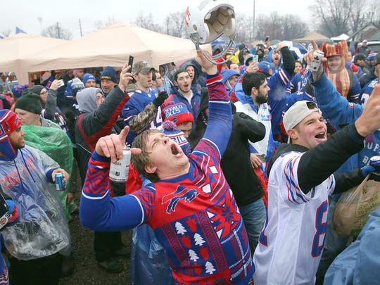 Bills fans dance at the Pinto tailgate gathering before