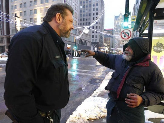 Eric Ratzmann, an MPD officer on the Homeless Outreach Team, talks with Dale Pavlenko in December 2013.