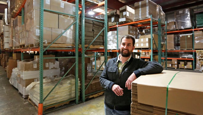 Joe VanDerPuy of Paper Box and Specialty Co. poses Tuesday, May 10, 2016, in the company warehouse. The company has announced expansion plans.