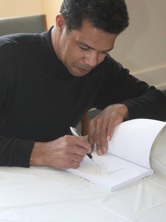 Sonny Signing.jpg