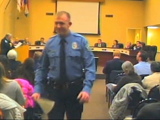 This image from a Feb. 11, 2014, video released by the City of Ferguson, Mo., shows Officer Darren Wilson. Wilson has told authorities that black teenager Michael Brown reached for a police weapon during a scuffle that preceded Brown's death.