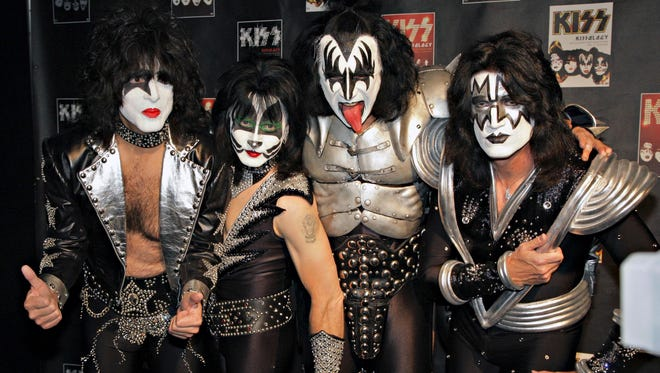 Members of Kiss, from left, Paul Stanley, Eric Singer, Gene Simmons and Tommy Thayer, pose for a photograph during a news conference to promote the start of their KISS Alive/35 European Tour  in Oberhausen, Germany, in 2008.