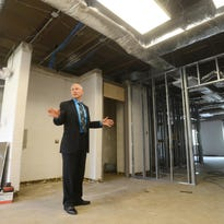 Larry Triplett, executive director of the Muskingum County Business Incubator, talks about the second floor of the facility, which is being refurbished so it can be put to use.