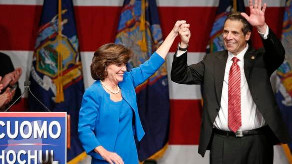 Democratic New York Gov. Andrew Cuomo, right, celebrates with Lt. Gov. Kathy Hochul after defeating Republican challenger Rob Astorino, at Democratic election headquarters in New York, Tuesday. Cuomo is the first New York state Democratic governor since his father to win re-election in the nation's third largest state.