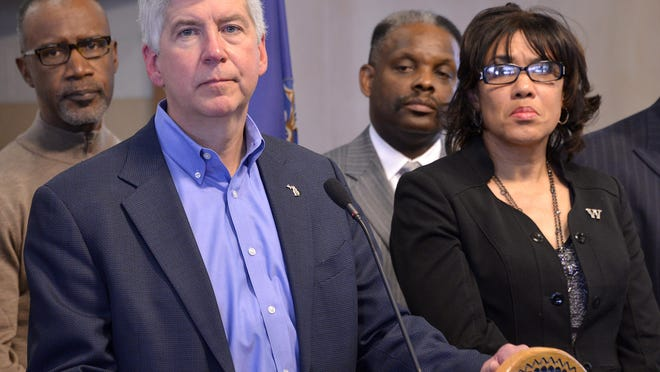 Gov Rick Snyder, Flint Mayor Karen Weaver and Michigan State Police Capt. Chris Kelenske during a news conference on Jan. 11 on the city's water crisis.