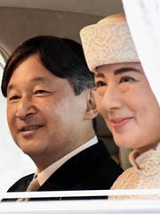 Japan's Crown Prince Naruhito, left, and Crown Princess Masako leave the Imperial Palace after attending the ceremony of Emperor Akihito's abdication.