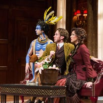 """Luigi (Dave Johnson) Phyllida (Karen Peakes) and Lucius (Daniel Frederick) examine a new breed of flower Lucius has discovered and named after Phyllida in the Delaware Theatre Company's """"The Explorers' Club,"""" which ends May 22."""