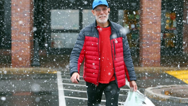 Steven Margulis of Basking Ridge comes out of Kings supermarket to snow as wicked winter weather expected to pick up within the next few hours, potentially dumping up to 18 inches in some areas. March 7, 2018.  Bedminster , NJ.