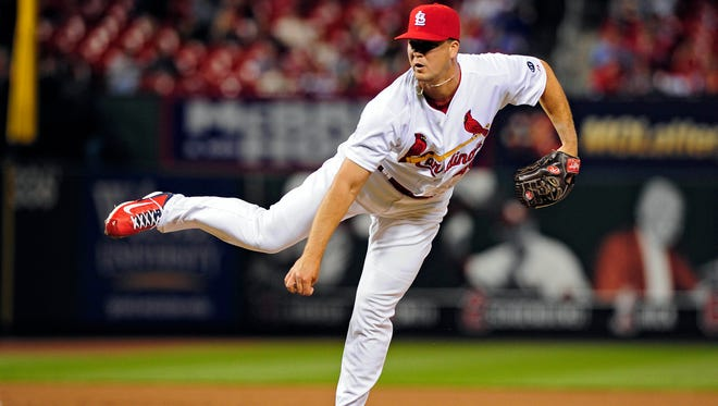 Cardinals reliever Mitch Harris kept his arm strong even while serving a five-year commitment in the Navy.