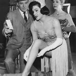 """In this March 1963 file publicity photo originally released by ABC, actor Robert Stack, portraying Prohibition-era crime fighter Eliot Ness, is shown with Patty Regan, center, and Sherry O'Neil, who play chorus girls in a scene from the ABC television show """"The Untouchables."""""""