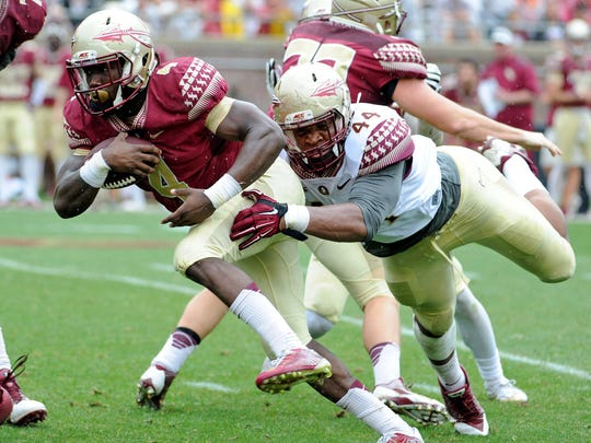 Apr 11, 2015; Tallahassee, FL, USA; Florida State Seminoles running back Dalvin Cook (4) is tackled by defensive end Demarcus Walker (44) during the spring game at Doak Campbell Stadium. Mandatory Credit: Melina Vastola-USA TODAY Sports