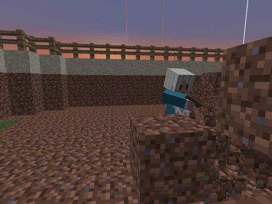 A student builds a virtual world in Minecraft.