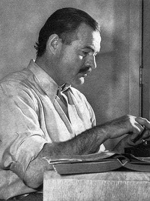 Hemingway poses for a photo at the Sun Valley Lodge, Idaho, late 1939.