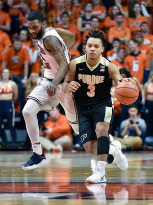 Purdue guard Carsen Edwards (3) makes a move down the court past Illinois guard Mark Alstork (24) during the first half of an NCAA college basketball game in Champaign, Ill., Thursday, Feb. 22, 2018.