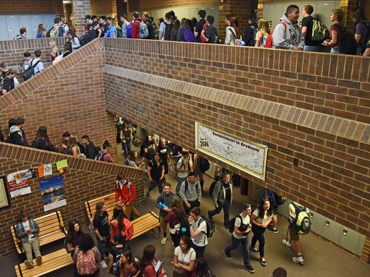 Students walk through the crowded hallways of Windsor High School on Thursday as they make their way between classes.