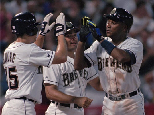Milwaukee Brewers David Hulse (15) and Pat Listach, center, congratulate teammate Darryl Hamilton, right, after Hamilton hit a grand slam against the Detroit Tigers in August 1995.