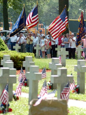 Veteran groups hold flags during a service at Landis Park at the end of the Vineland Memorial Day Parade held Monday May 31, 2010. - Staff photo/Cody Glenn