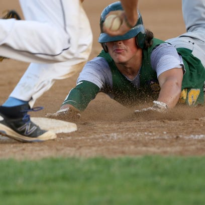 D.C. Everest's Brady Uekert slides into third base a moment too late and is called out during the American Legion Regionals, region 2, July 20, 2016.