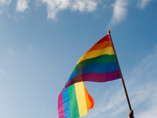 Rainbow-colored gay pride flag waving in the sky