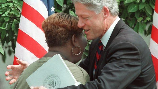 President Clinton hugs former welfare recipient Lillie Harden, of Little Rock in the Rose Garden of the White House on Aug. 22, 1996, when he signed legislation overhauling America's welfare system.