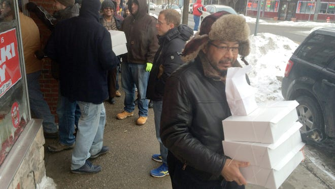 Corliss Parker, 71, of West Bloomfield continues a family tradition Tuesday picking up Paczki from New Palace Bakery, a place he's been visiting since the early 1970s.