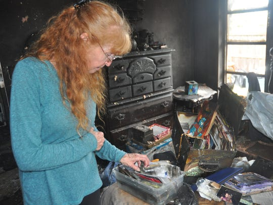 Cindy Buehl is salvaging family mementos she finds in the rubble of her house. A May 9 fire destroyed the Buehl family home in Bonita Springs.