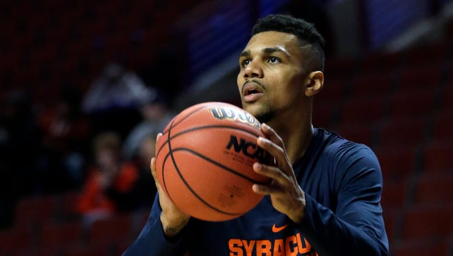 Michael Gbinije shoots during practice for Syracuse University in March 2016.
